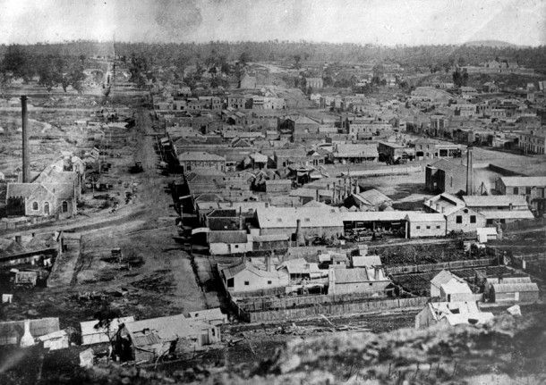 View of Castlemaine in the early 1860s. Courtesy Verey Collection. View looking west down Forest Street. The chimney at left centre is the Castlemaine Gasworks. Photo C.1865?