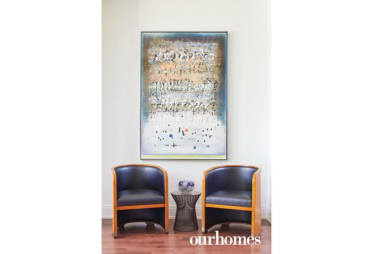 "The owner's vintage chairs are paired with a piece titled Open Secret by Alice Teichert.    See more of this home in ""Peanut Factory Loft in Toronto's Cabbagetown"" from OUR HOMES Toronto Summer 2017:  http://www.ourhomes.ca/articles/build/article/peanut-factory-loft-update-in-torontos-cabbagetown"