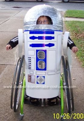 R2D2  Costume: I made this R2D2 costume so that my 6 year old son, who has cerebral palsy, would be the coolest kid in elementary school for the parade.    I am pretty
