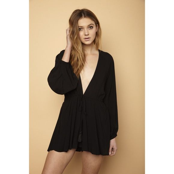 Black Plunge Flowy Bell Sleeve Romper Long sleeve flowy romper with waist tie and deep v cut. Unlined  Imported Dresses Mini