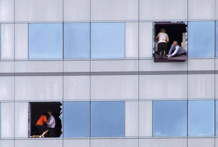 Office workers look for a way out of a high rise building in central Christchurch, New Zealand on February 22. A strong earthquake killed at least 180 people.    (Reuters / Simon Baker)