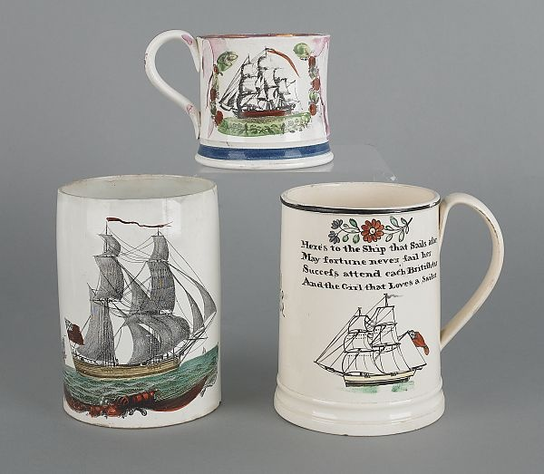 """Three Staffordshire mugs of maritime interest, early 19th c., each with ship decoration, 3 3/4"""" h., 5 3/4"""" h. and 6"""" h."""