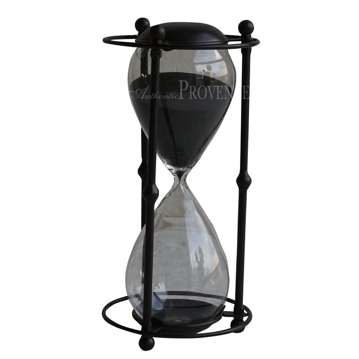 Decorative and oversized hour glass sand timer with a dark brown opaque metal trim and black sand, runs up to one hour.