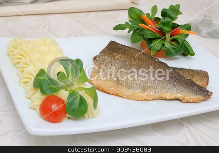 Baked fillet of sea bass stock photo