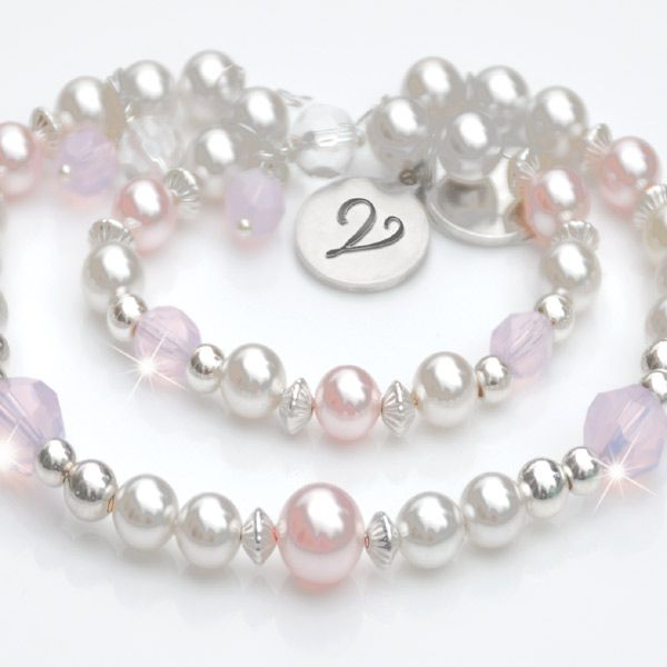 Emily Rose Mother & Daughter Bracelets - Celebrate the bond between mother and daughter with these enchanting matching bracelets. Emily Rose is also perfect for Grandmother and Grand-daughter.Crafted in sterling silver with white and baby pink Swarovski pearl and sparkling opal rose crystal. Each bracelet has a dainty 10mm Alchemé silver disc stawith your initial