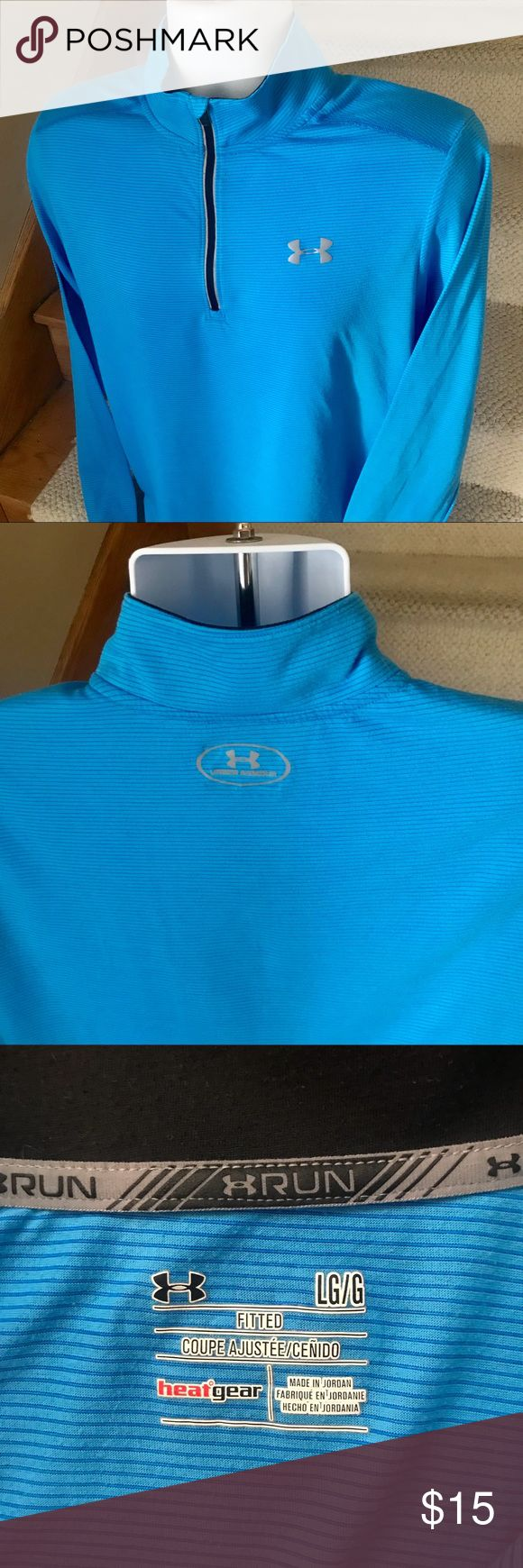 Under Armour Heat Gear zip athletic running shirt Authentic men's Under Armour Fitted 1/4 zip athletic running shirt that is sized large.  Under Armour logo on the chest and top of the back.  Made out of Heat Gear wicking fabric.  Gently used condition. Under Armour Shirts Tees - Long Sleeve #runningshirt