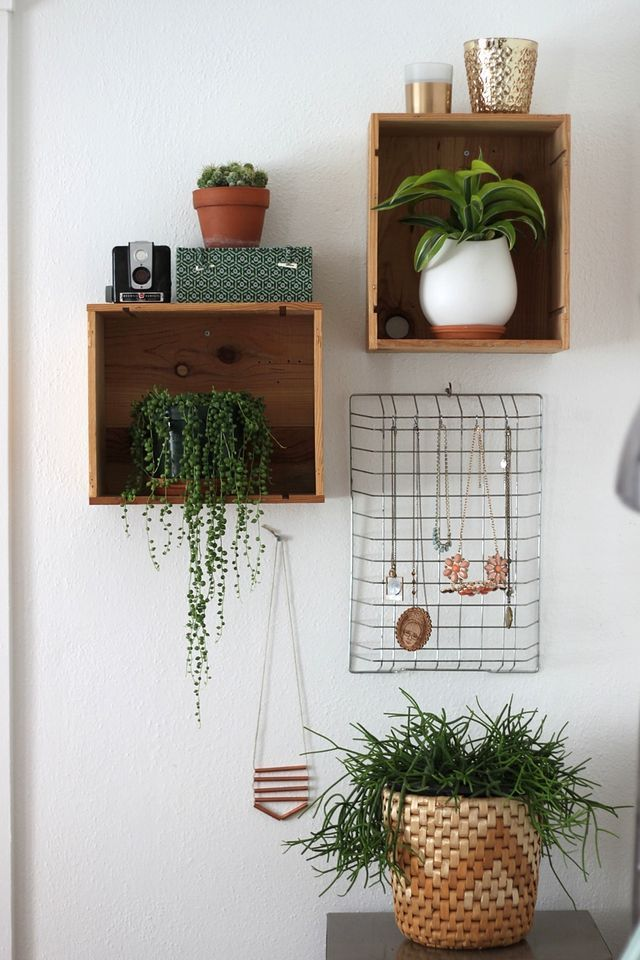 Plants in the bedroom. The crates on the wall helped create a little bit of storage and turned our dirty laundry basket corner into something less mundane. #home #DIY #wall