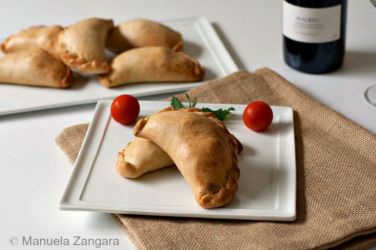 Baked Empanadas - a popular street food in many Latin and South American nations - this recipe - the classic Argentinian Beef, Veggie, Raisin and Olive Stuffed Empanadas