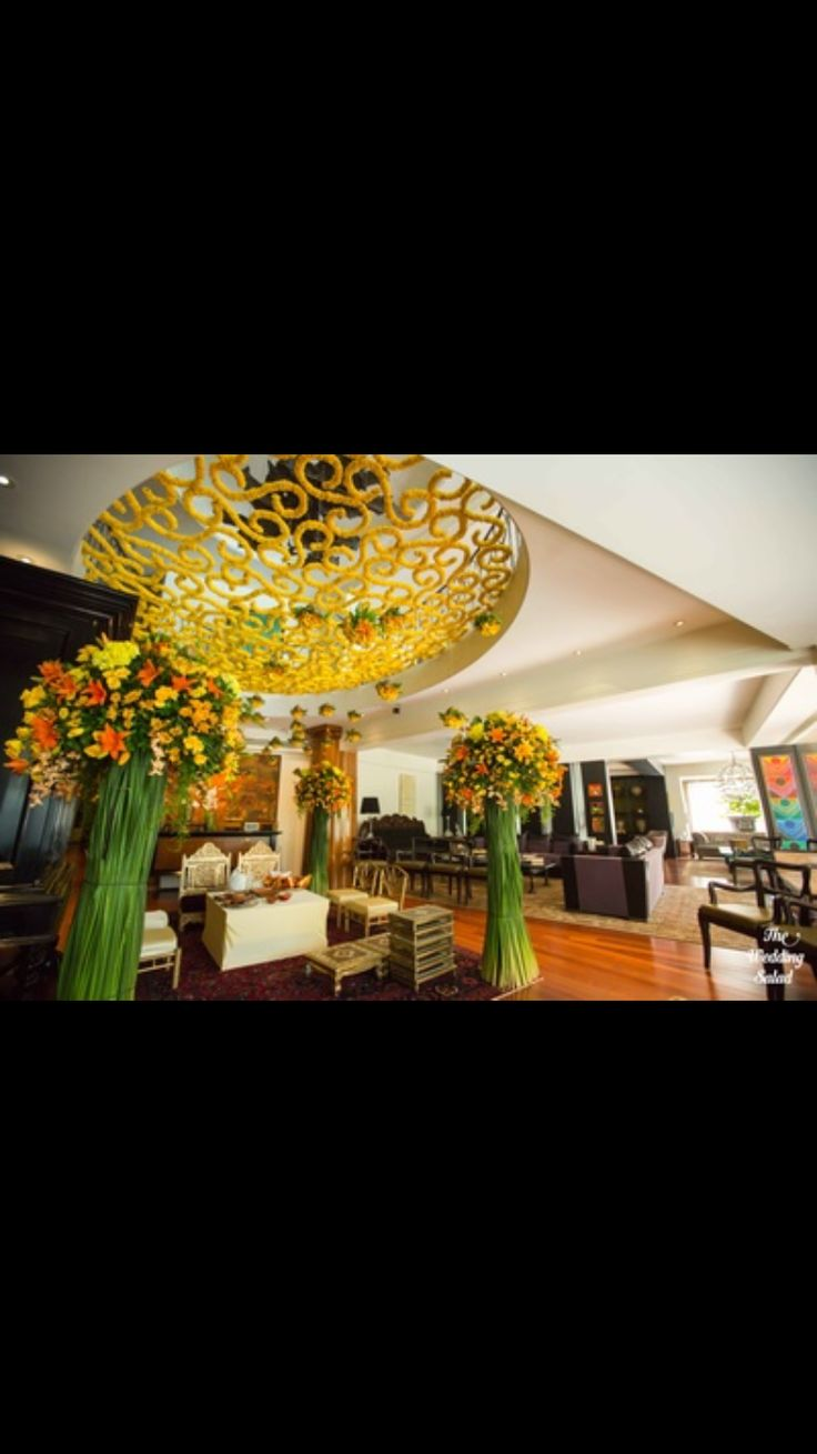 I just love this in home decor... The most important and the foremost part of any wedding is decorating the house with flowers.. The decoration is done with utmost care it is soo classy yet tradition with the use of lot of yellow flowers just in awe with this decor