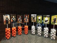 HS Graduation Open house centerpieces. Had 12 tables. Used the 3 sports my son played (golf not in picture) Put bouncy basketballs, soccer balls and real golf balls in vase then added each years' (freshman - Senior) individual sport picture.