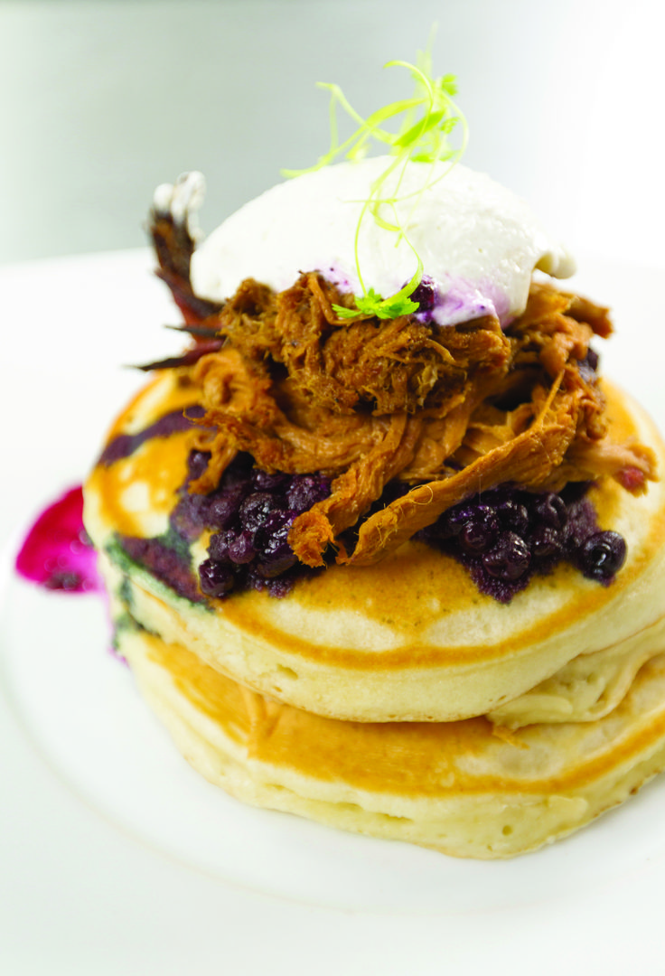 """Right in the heart of Toronto, the Barque Smokehouse is known for its unique brunch menu. These """"smoked duck pancakes"""" will have you craving breakfast for dinner every night of the week."""