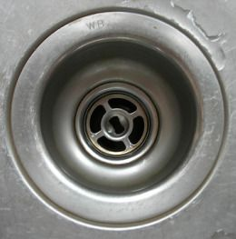 All natural Drain-O -- great for slow draining tubs!  -put 1 cup baking soda in drain  -slowly wash down with 1 cup boiling water  -put another 1 cup baking soda in drain  -wash down with 2 or 3 cups vinegar (it will bubble)  -Let sit for about 5 minutes  -Slowly wash down with more boiling water    ----This worked and my drain progressively got faster over the next couple days.  REPEAT IF NECESSARY.
