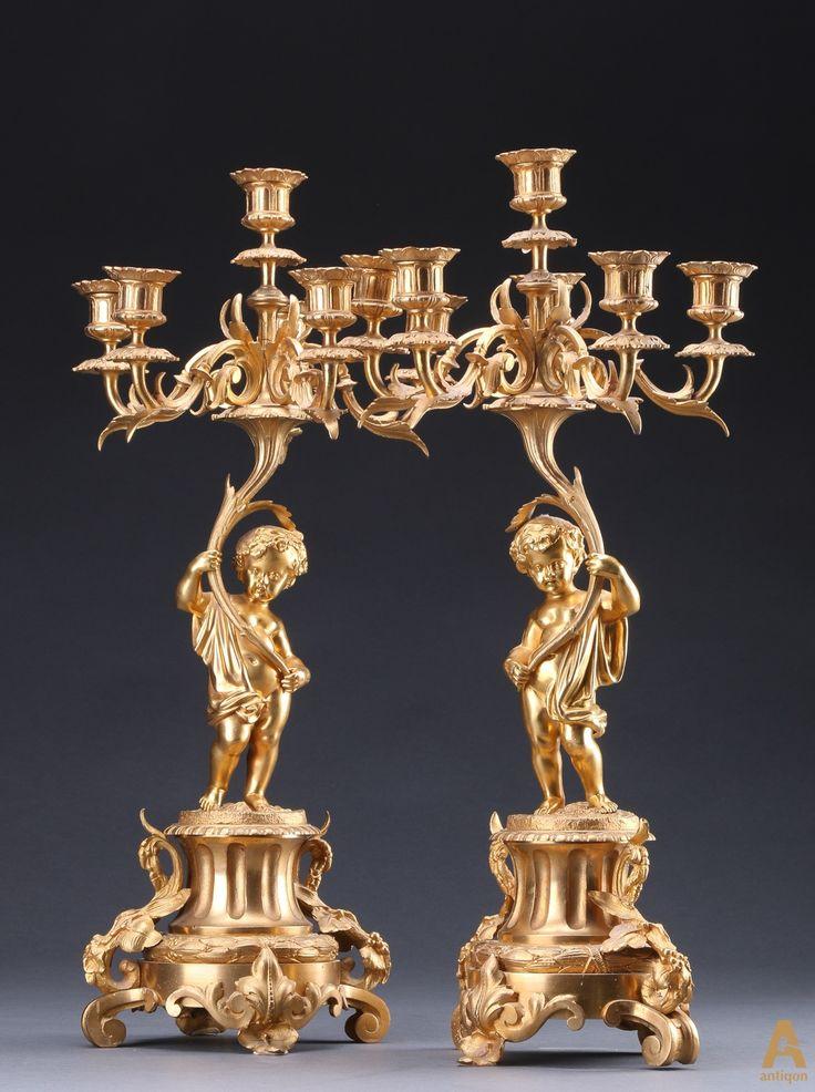 Уникальная пара канделябров на шесть свечей, выполненные из позолоченной бронзы , богато украшенные  художественным литьем в виде  фигур Путти,гирляндами цветов и листвы. 1870 год.