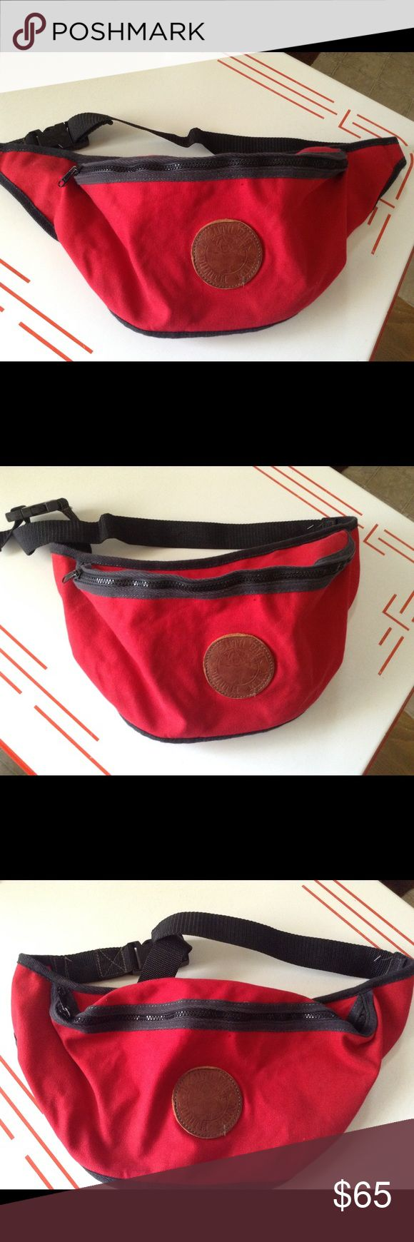 Duluth Pack Large Fanny Pack Duluth Pack brand Large size fanny pack. Cherry red canvas with leather detail. Red is a discontinued color and is in great shape. No rips, holes or any damage. Heavy duty zipper and buckle. Can be worn around the waist, or over your head and shoulder like a sling bag. Duluth Pack Bags Backpacks