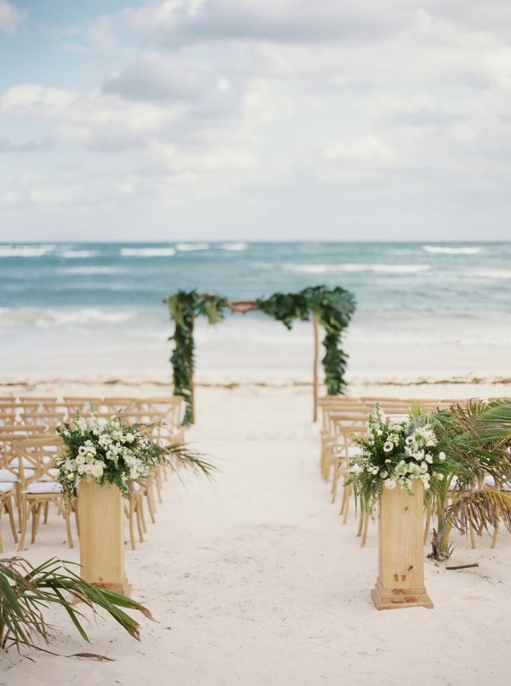 Beach ceremony in Tulum. Event Planning: Fresa Weddings | Floral Design: Vanessa Jaimes Floral Design | Wedding Venue: Akiin Beach Club. Photography: Kyle John Photography - www.kylejohnphoto.com/