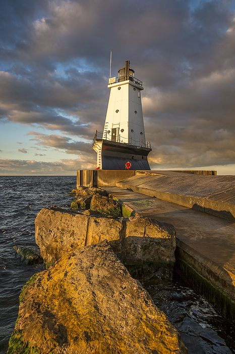 The Ludington Light is a 57-foot tall steel-plated lighthouse in Ludington, Michigan, which lies along the eastern shores of Lake Michigan, at the end of the breakwater on the Pere Marquette Harbor.