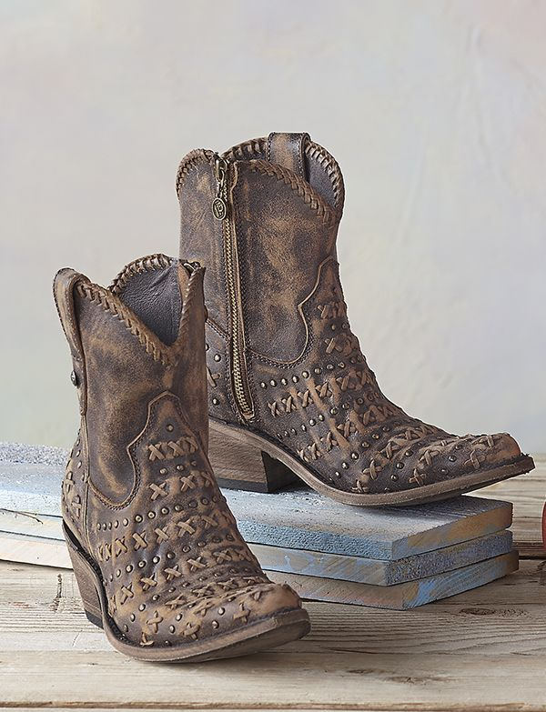 Buttersoft, handcrafted boots are an ode to the Wild West, signed with one-of-a-kind Xs and Os in stitches and studs.