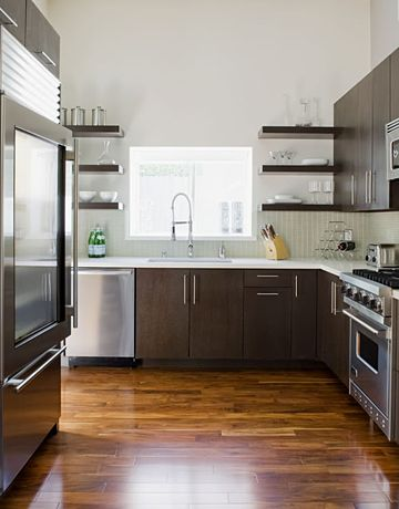 Not sure how I feel about the floating shelves on either side of the window. Jeff Lewis design