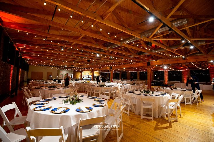 All of the tables, chairs, linens, and napkins are included in the rental of Rhinegeist's Clubhouse!.Photo by Chocolate Paper Studios