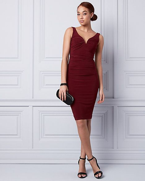 Knit V-Neck Pleated Shift Dress - A deep, tasteful V-neckline fronts a classic cocktail dress finished with flattering pleats.