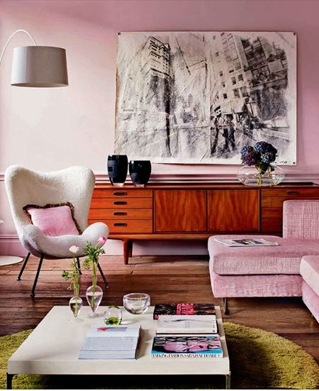 Pink walls, midcentury furniture. Cool space for the modern girly girl.
