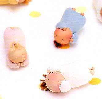 pictures show how to make these tiny cute dolls