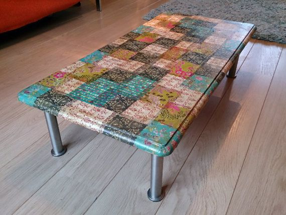 Decoupage Coffee Table **I did this with different sized leaves cut out from green and floral patterned scrapbook paper and covered the top with a piece of cut glass.**
