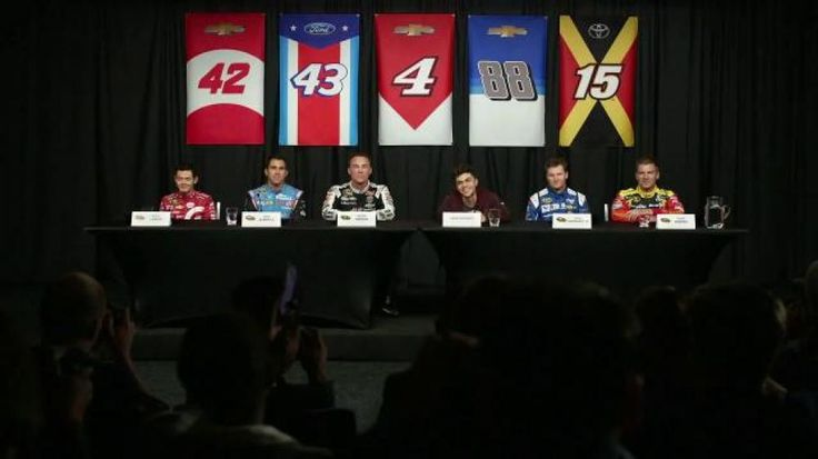"""Zack Buckner is the owner of the fantasy NASCAR team """"Can't Touch This"""" and he is loving the attention at a press conference. Together with his drivers, The Hapster, Double A, Larson, Easy B and DJ Craze, Zack is living the winning life in the fast lane thanks to NASCAR Fantasy Live."""