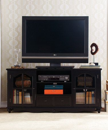 organize your home with this sleek black media cabinet from hanover the cabinet includes two glass door side cabinets a convenient drawer