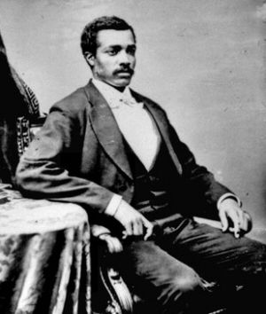 Elected to Congress in 1870, Josiah T. Walls became Florida's first elected black Congressman. Born a slave in 1842, he was conscripted by the Confederate Army and captured in Yorktown by Union forces in 1862.  Walls then enlisted in the U.S. Colored Troops Infantry Regiment in 1863 where he rose in rank to First Sergeant.  After passage of the U.S. Military Reconstruction Act of 1867, Walls joined the Republican Party and within three years was a member of Congress.