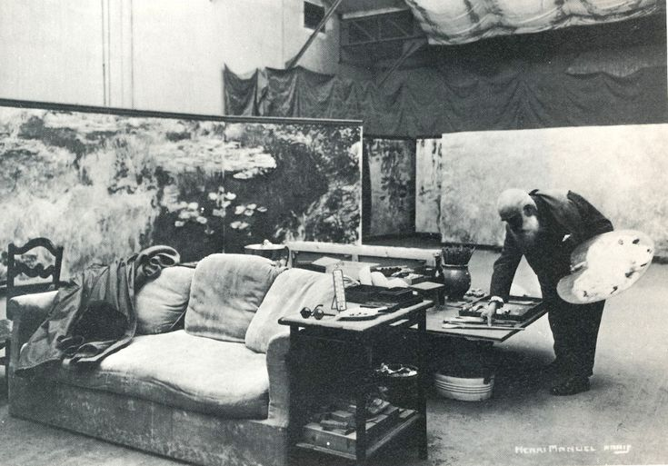 claude monet in his third studio, surrounded by panels of his large 'water lilies' series, 1920s