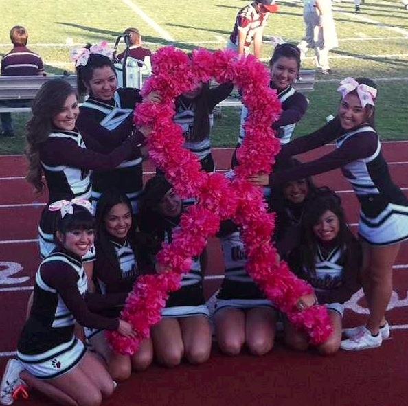 Varsity cheerleaders at our pink out football game