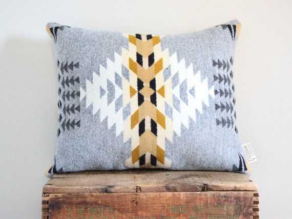 This pillow is hand sewn and made with a newly released Pendleton Woolen Mill patterned wool. The front is a heathered grey and white with cream,