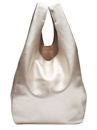 Small tote bag in platinum from Baggu. This leather bag features two handles and a raw cut top. Measures 12