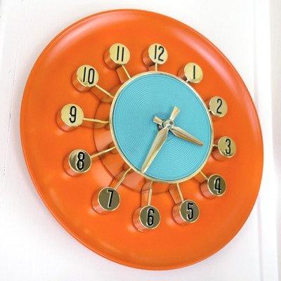 orange atomic clock. Repinned by Secret Design Studio, Melbourne,  https://www.facebook.com/SecretDesignStudio