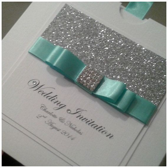 This general idea looks gorgeous.. not necessarily silver glitter board, or a pocket invite, but just the front panel..