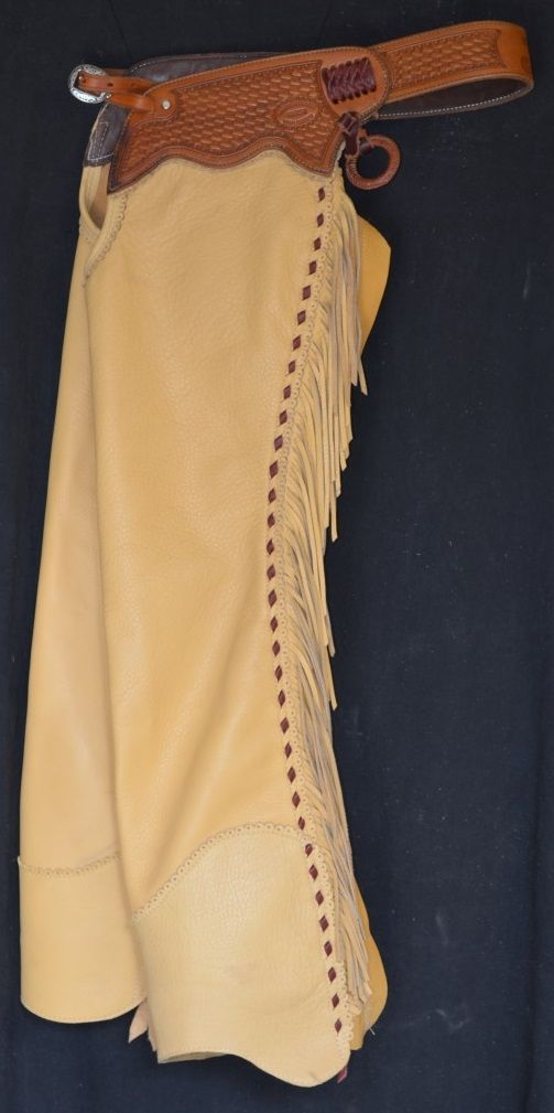 Custom made shotgun chaps. Hand pinked borders with buck stitch. 5 oz glove tan cow leather in saddle color.