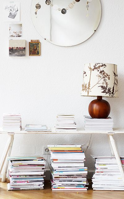 a happy collection of magazines & a fabulous retro lamp on top ~ @Holly Hanshew Becker's home