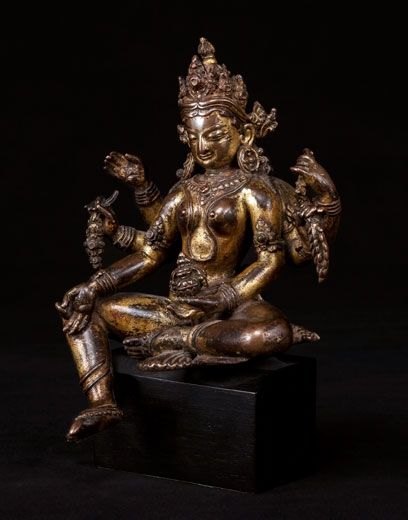 Vasudhara. Nepal, 13th/14th century. Gilt Copper. Height: 7.5 inches (19 cm)