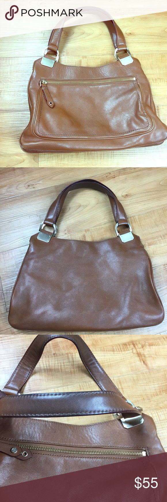 Tan Brown Cole Haan Purse Handbag w/ Gold Hardware Tan Brown Cole Haan Purse Handbag w/ Gold Hardware.  Very good condition Lining is clean Piping is slightly exposed. Please see photos.   Thanks for looking! Cole Haan Bags Satchels