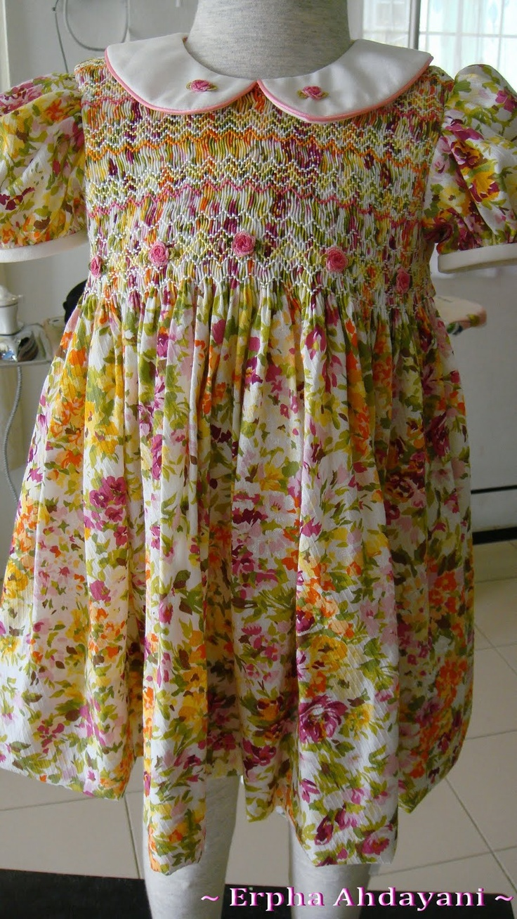 Full bodice smocked dress in cheerful colours; I embroidered cast-on roses to make them stand out on the busy prints.