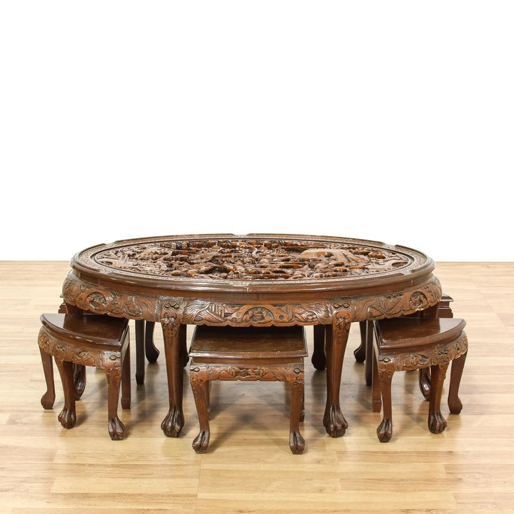 This coffee table set is featured in a solid wood with a glossy rosewood finish. These Asian-style stools and coffee table have an oval top with an intricately carved battle scene, paw feet, and dragon motifs. Perfect for serving tea! #asian #tables #coffeetable #sandiegovintage #vintagefurniture