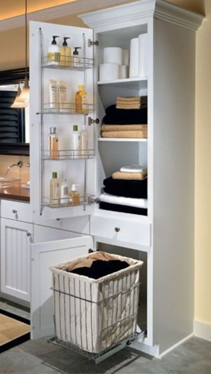 linen closet with chrome shelving rack on door and a removable pullout hamper bathroom ideas