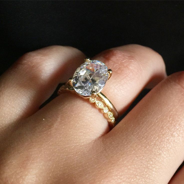 3 carat oval diamond engagement ring. Solitaire with vintage wedding band. Oval solitaire