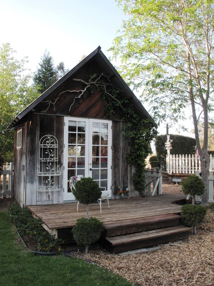 rustic backyard shed modernized with front deck and patio doors
