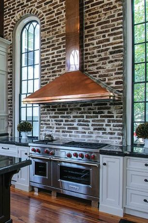 Eclectic Kitchen with Flat panel cabinets, Arched window, Kitchen island, Pendant Light, One-wall, High ceiling