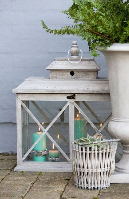 white lanterns, turquoise candles , large white urn with fern, so pretty