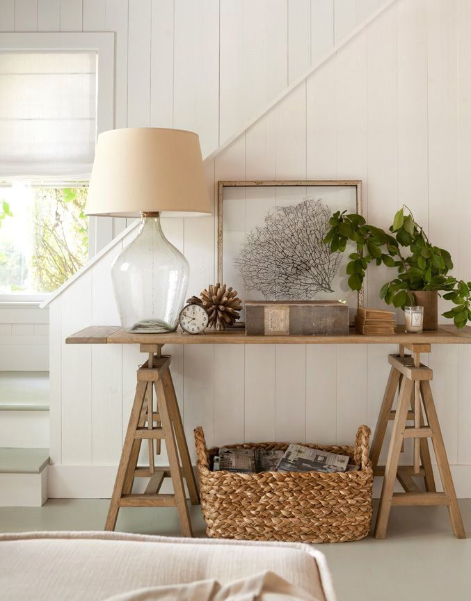 Modern Farmhouse Coastal Style In A Living Room Featuring Rustic Wood Side Table Styled With