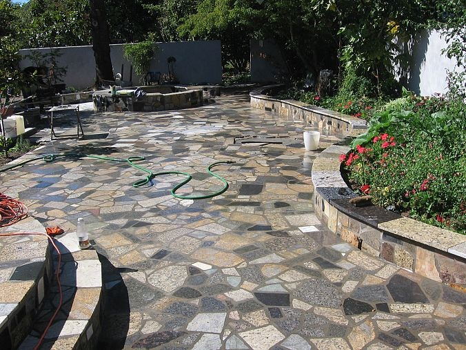 Beautifully paved steps and flower box and patio.