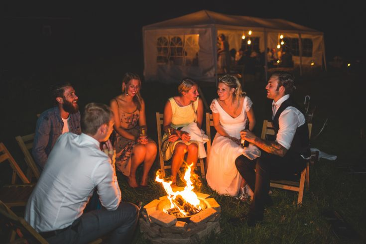outdoor fire - Image by Photography34 - A rustic styled low budget DIY wedding with outdoor venue, handmade bridal gown and handmade bridesmaid dresses. High street tweed groomsmen and dove grey colour scheme.